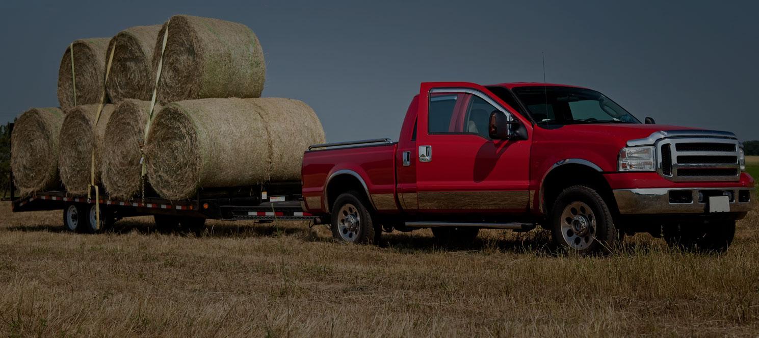a truck hauling hay darkened